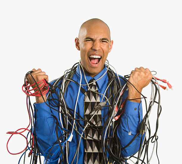 Man wrapped in cables. stock photo