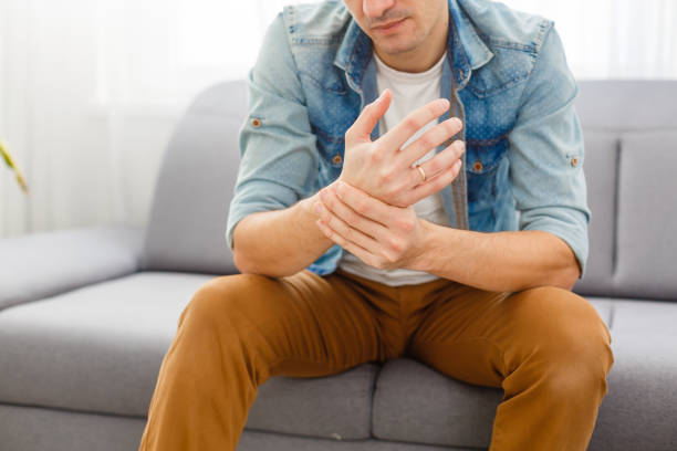 Man wrist pain Man wrist pain gout stock pictures, royalty-free photos & images
