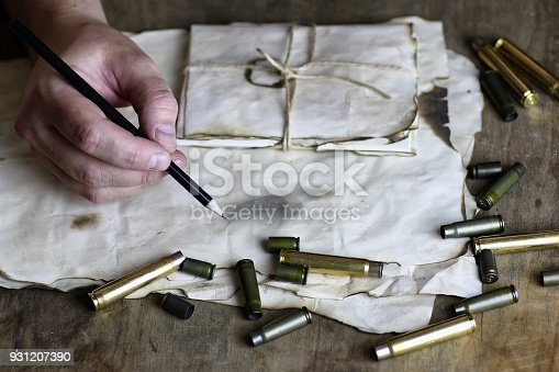 istock man write letter retro bullet on the table 931207390
