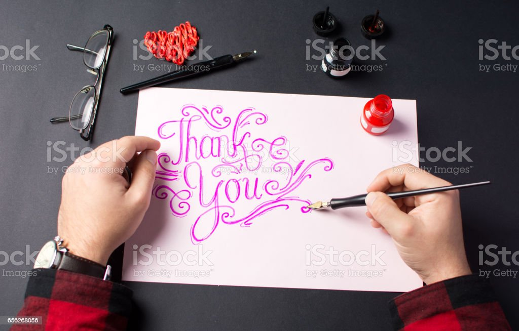 Man writing a Thank you note stock photo