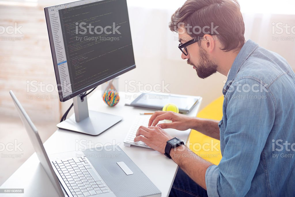 Man writing codes on computer stock photo