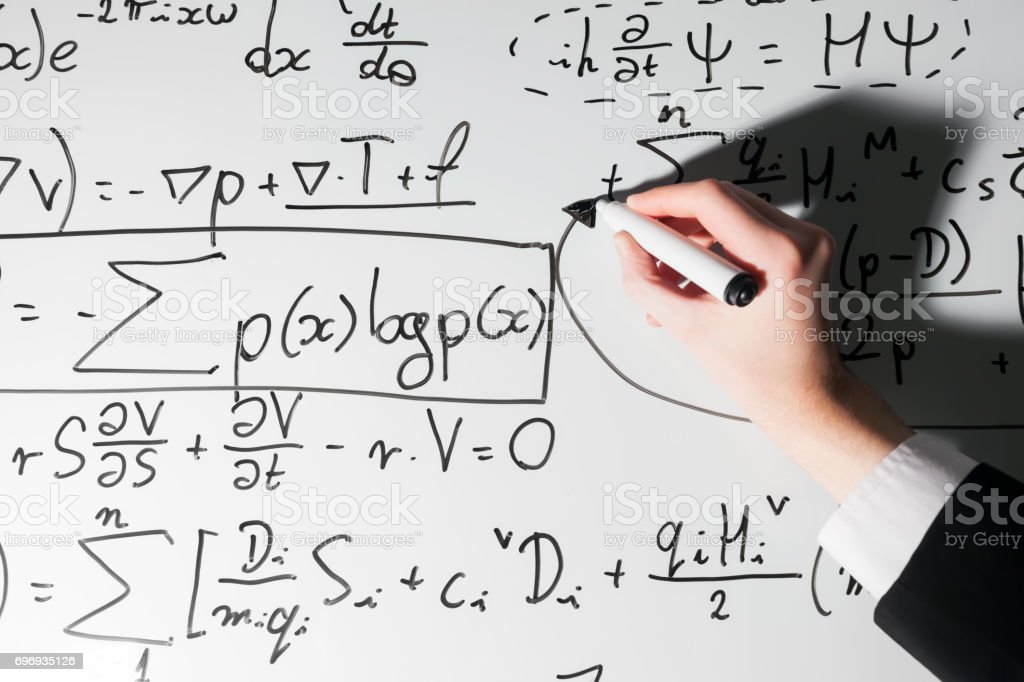 Man Writing Complex Math Formulas On Whiteboard Mathematics And ...
