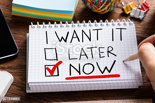 istock Man Writing I Want It Now 921349664