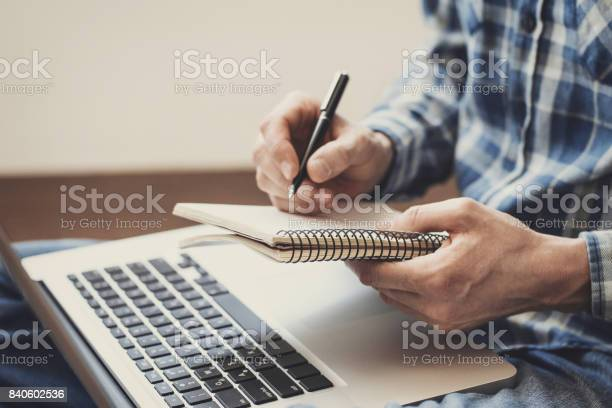 Man Writing In Notebook Stock Photo - Download Image Now