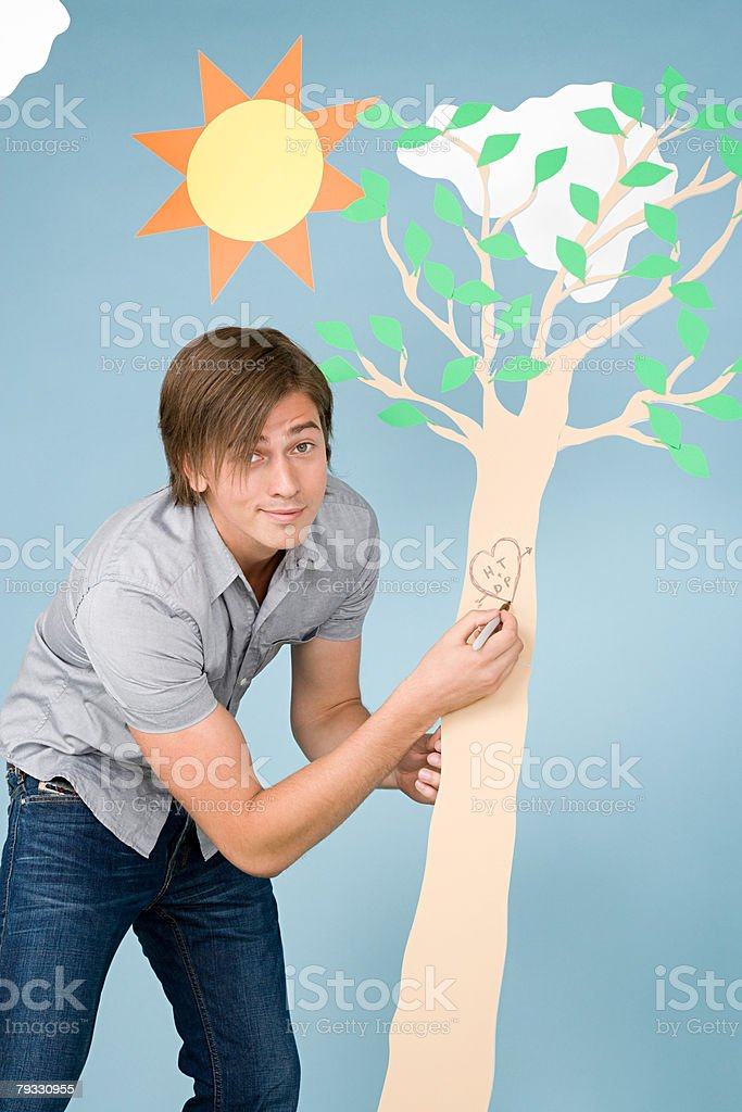 A man writing on a tree royalty-free 스톡 사진