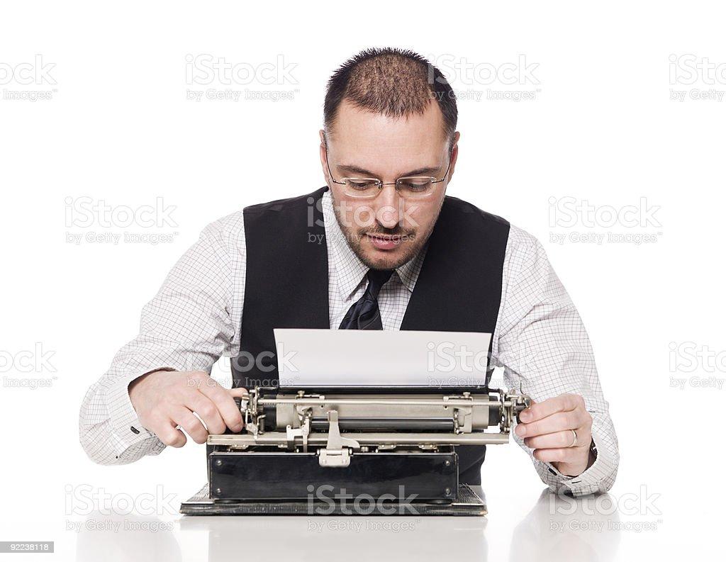 Man writing on a typewriter royalty-free stock photo