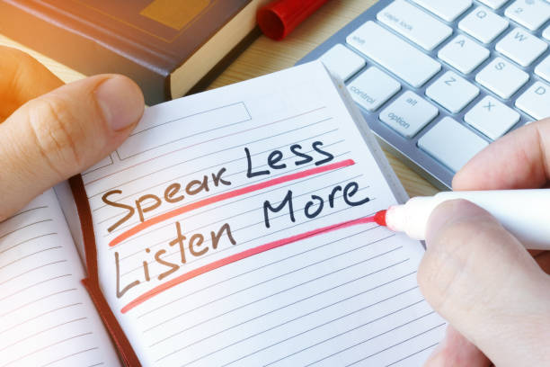 man writing quote speak less listen more. - listening stock pictures, royalty-free photos & images