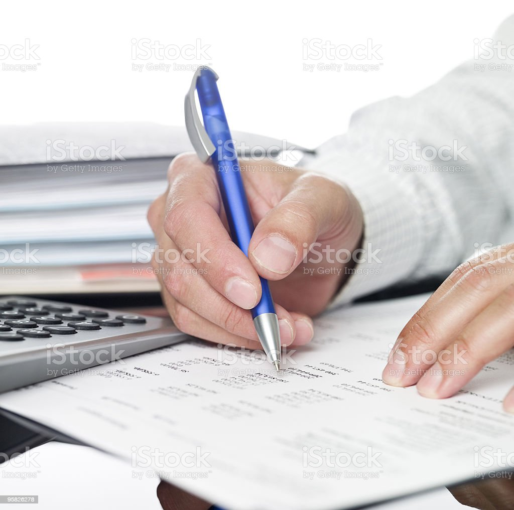 Man writing with a blue pen royalty-free stock photo