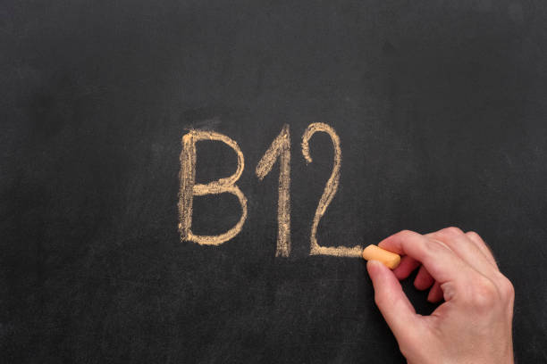 man writing word b12 on chalkboard - deficient stock pictures, royalty-free photos & images