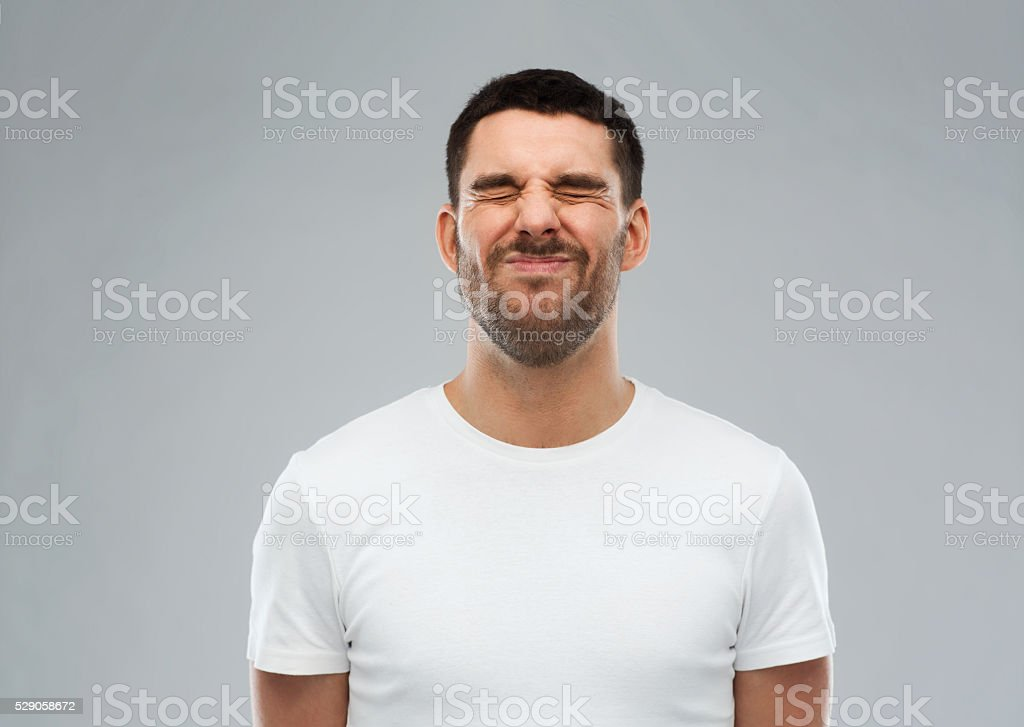 man wrying over gray background stock photo