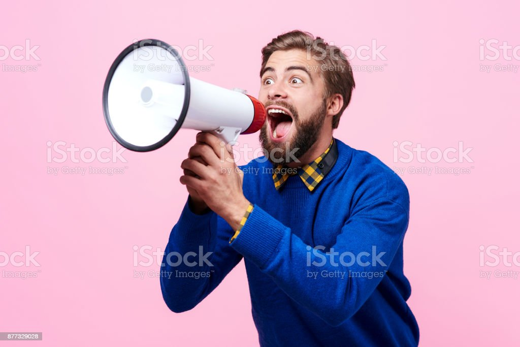 Man yelling into a megaphone stock photo