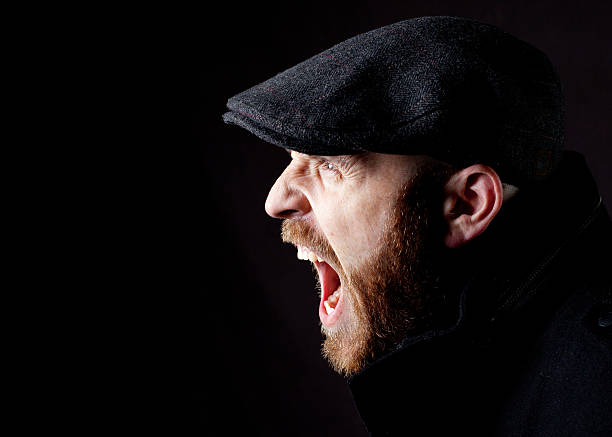 Man Yelling Profile of a man in hat yelling. fine art portrait stock pictures, royalty-free photos & images