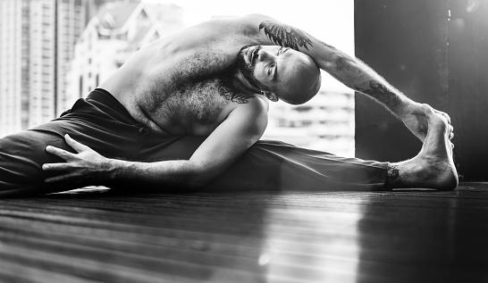 Man Yoga Practice Pose Training Concept Stock Photo - Download Image Now
