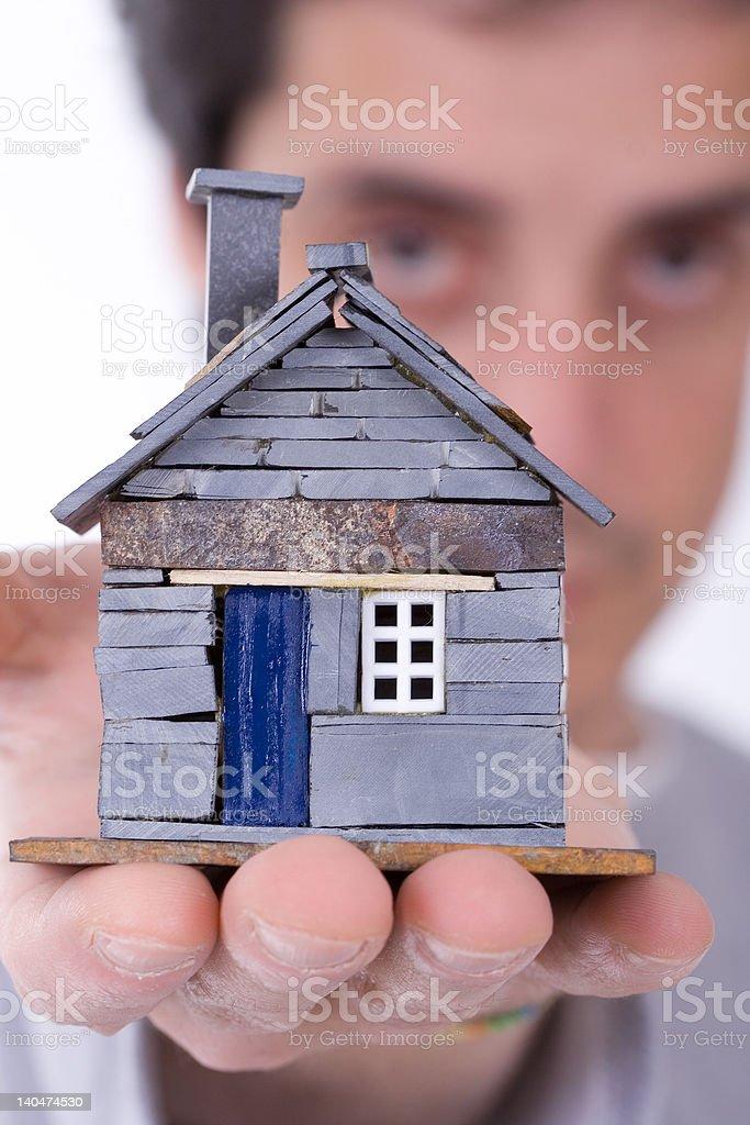 Man_holding_house royalty-free stock photo