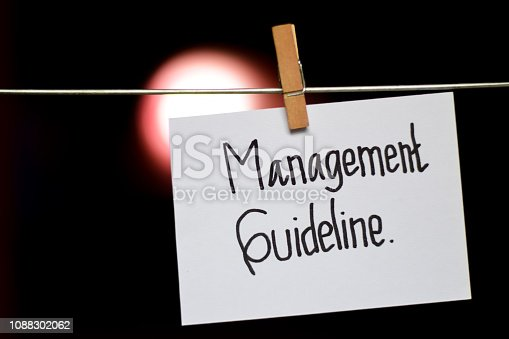 istock Management Guideline handwriting on paper. 1088302062
