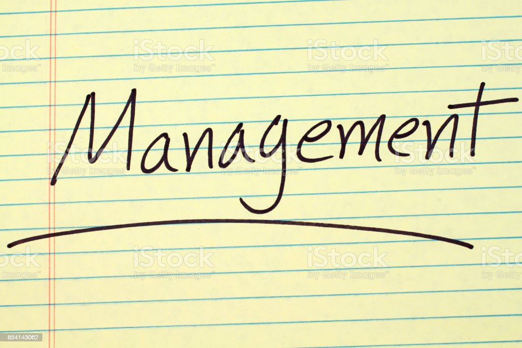 Management On A Yellow Legal Pad stock photo