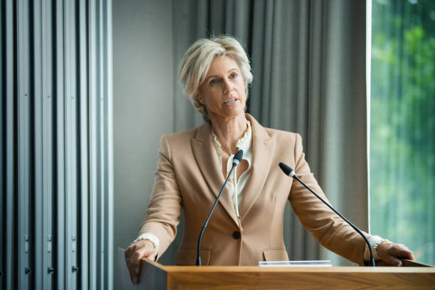 Management staff speaking at a company meeting stock photo