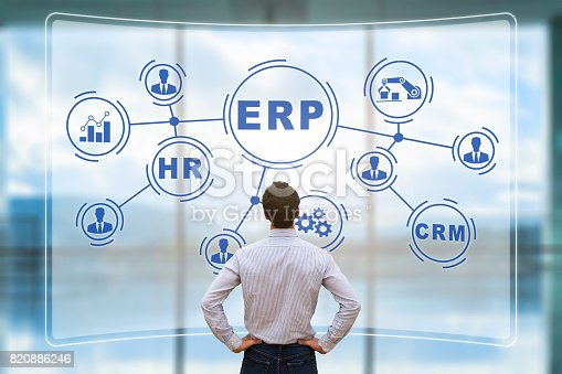 istock Manager analyzing ERP on AR screen, connections, BI, HR, CRM 820886246