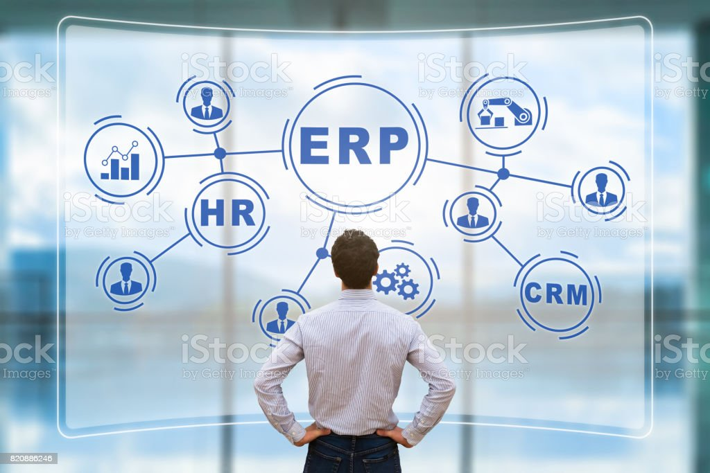 Manager analyzing ERP on AR screen, connections, BI, HR, CRM stock photo
