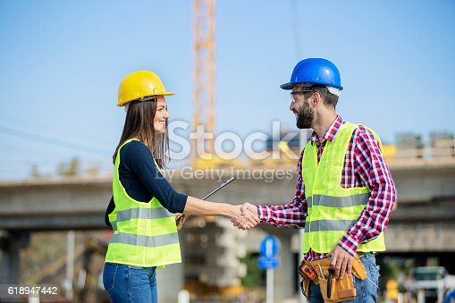617878058 istock photo Manager and employee shaking hands 618947442