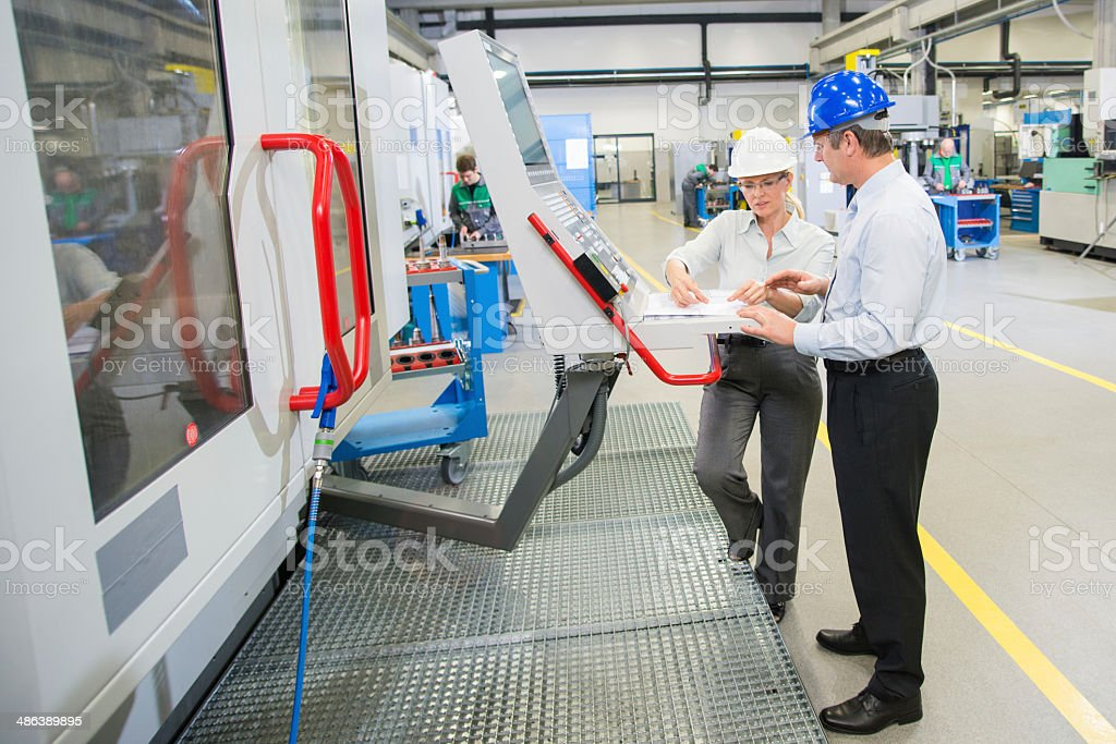 Manager And Engineer Programming A CNC royalty-free stock photo