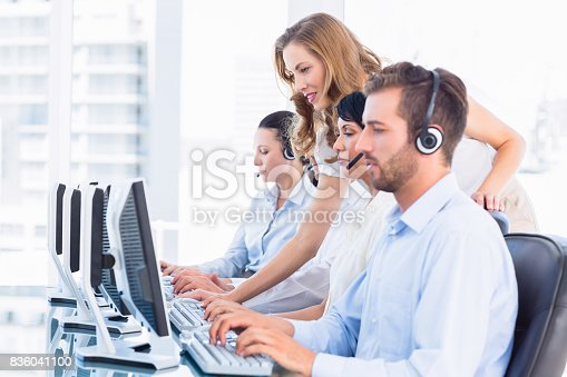 istock Manager and executives with headsets using computers 836041100