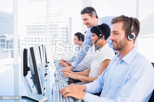 istock Manager and executives with headsets using computers 836041192