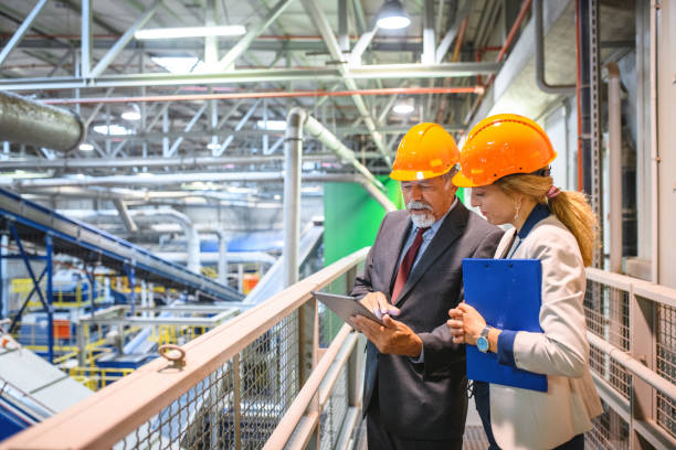 Manager and Quality Controller Inside Recycling Facility stock photo