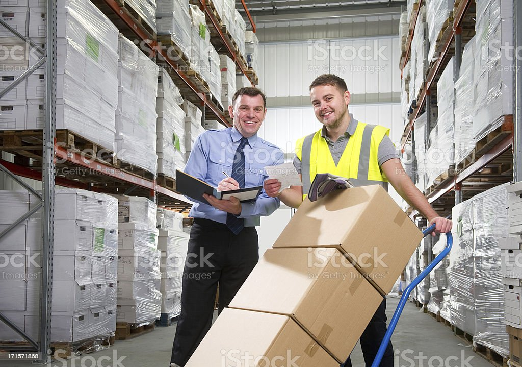 Manager and Warehouse Worker with a Hand Truck royalty-free stock photo