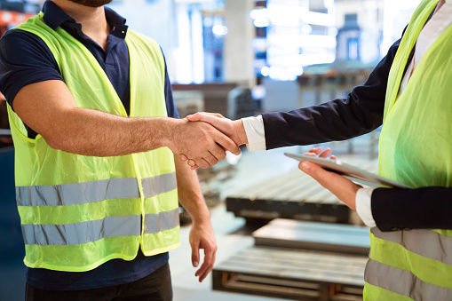 Manager And Worker Greeting Each Other In Factory Stock Photo - Download Image Now