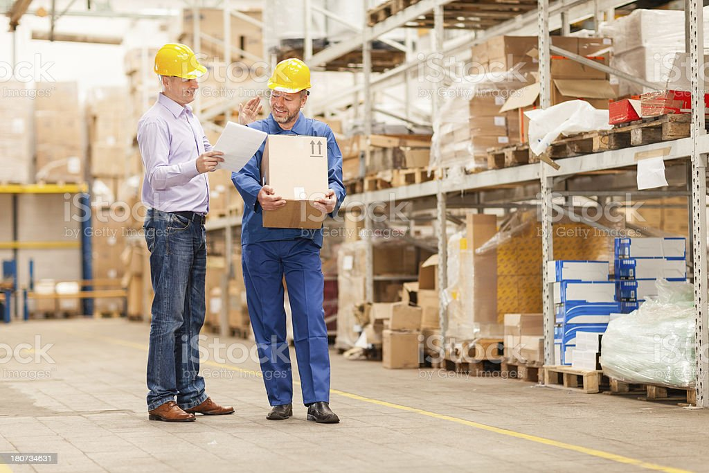 Manager and worker in warehouse royalty-free stock photo