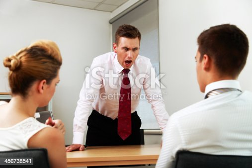 463813207 istock photo Manager angry at his coworkers 456738541