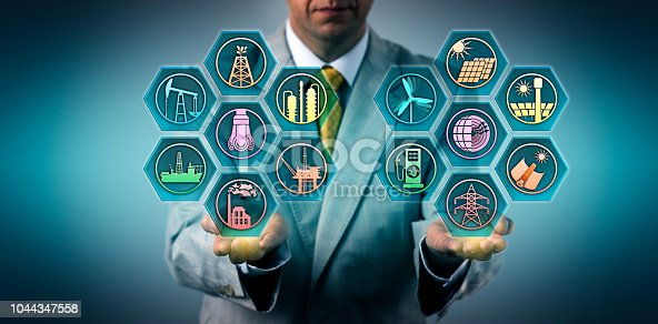 istock Manager Balancing Fossil And Renewable Resources 1044347558