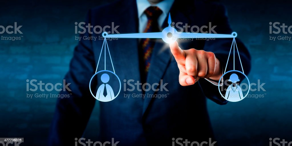 Manager Balancing Out A Female And A Male Worker stock photo
