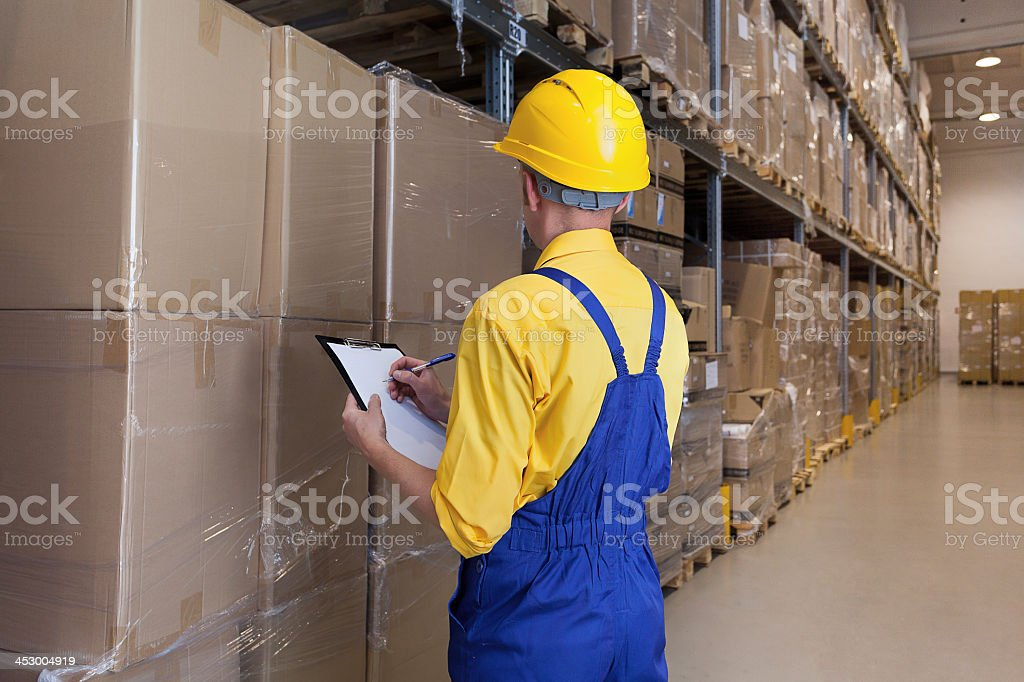Manager checking products stock photo