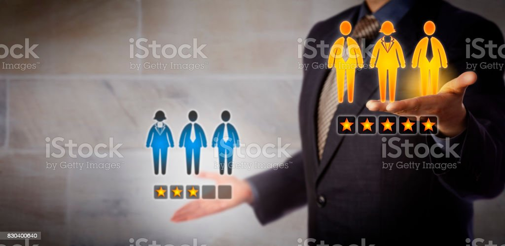 Manager Comparing Performance Of Two Work Teams stock photo