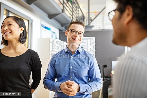 1150572092istockphoto Manager discussing with his team in office 1150572133