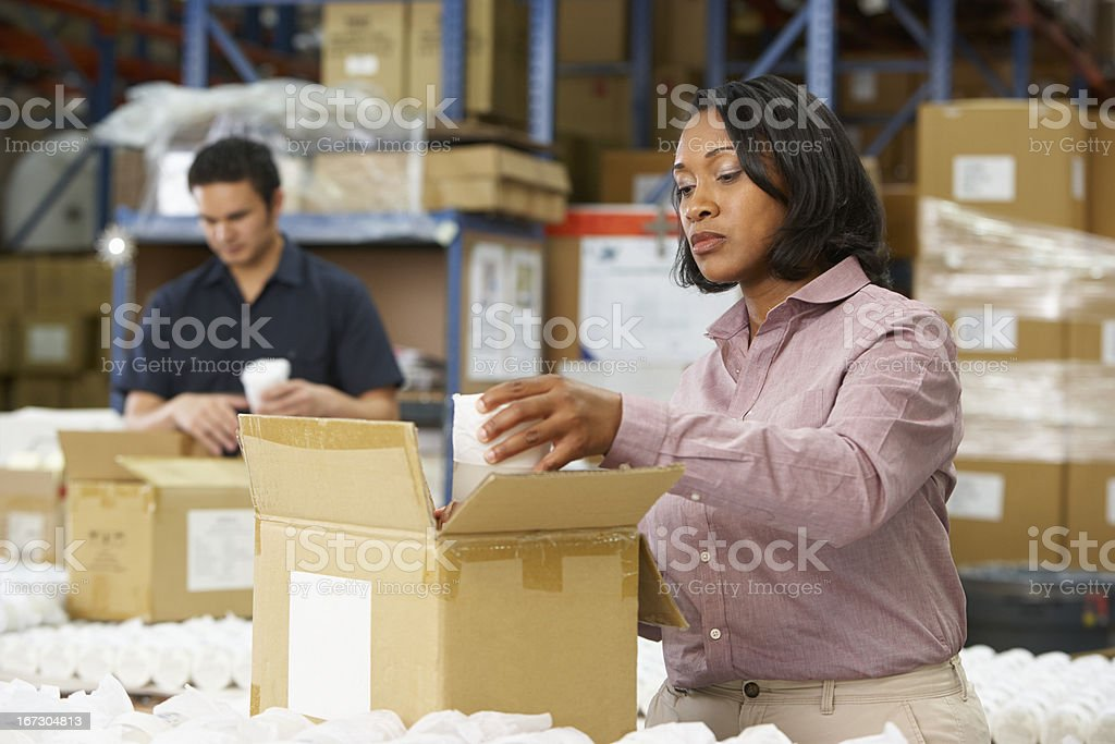 Manager does quality control on assembly line package royalty-free stock photo