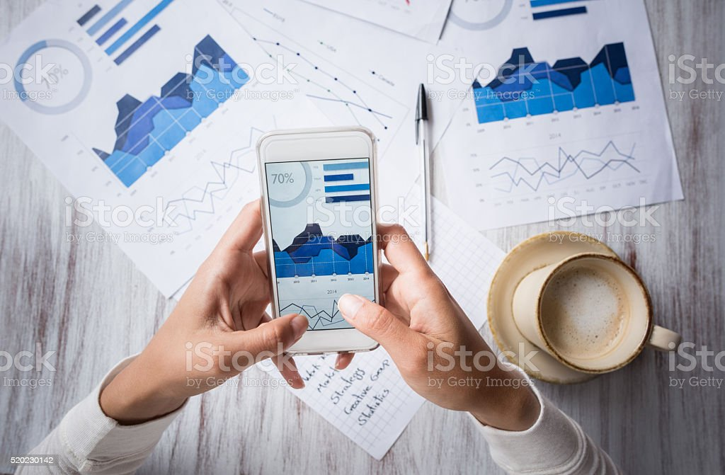 Manager doing the books at a restaurant stock photo