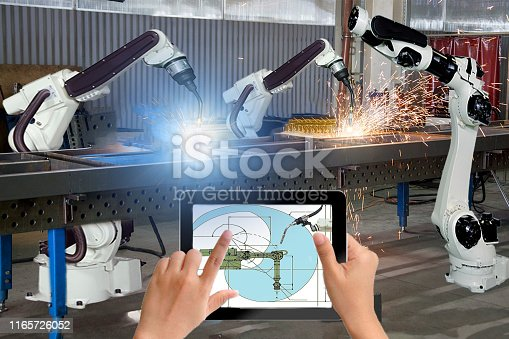 1091790362 istock photo Manager engineer check and control automation robot arms machine in intelligent factory industrial on real time monitoring system software. Modern Welding robotics and digital manufacturing operation 1165726052