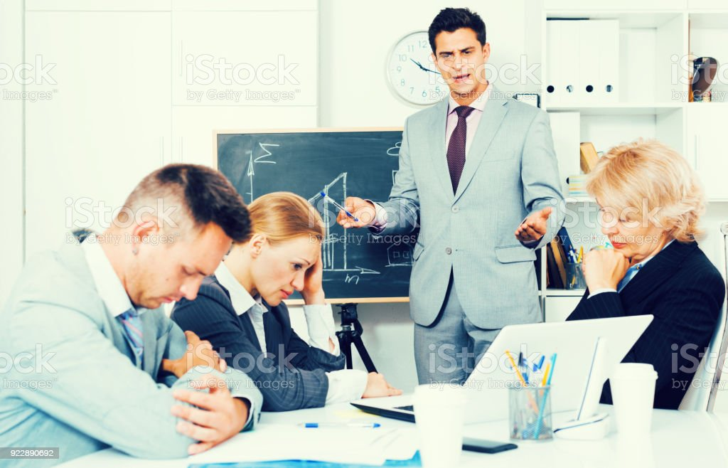 Manager expressing dissatisfaction with colleagues stock photo