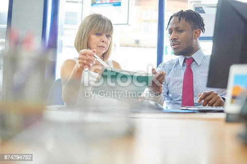 istock Manager giving employee appraisal 874294752