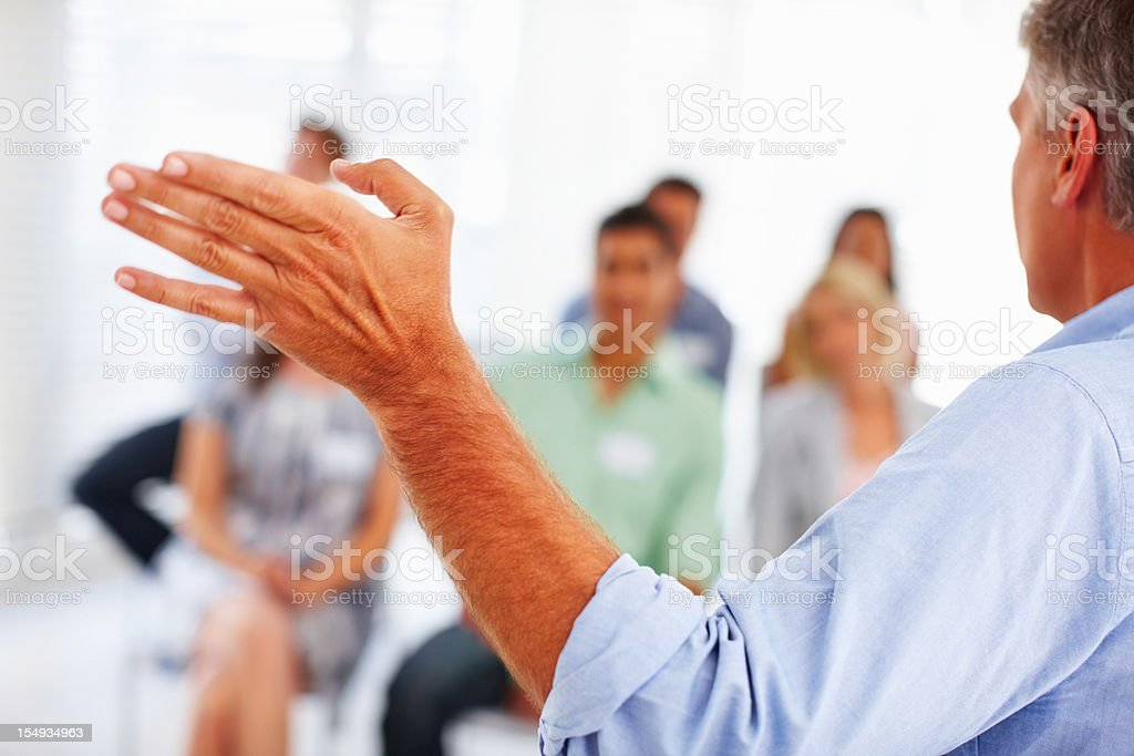 Manager giving presentation to business people royalty-free stock photo