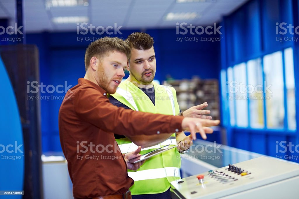 Manager giving work instructions to foreman stock photo