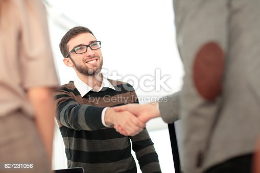 istock Manager greeting new employee and smiling in office 627231056
