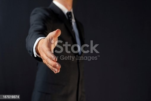 istock Manager handshake: business man giving hand 157019374