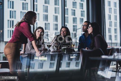 Business meeting in restaurant.