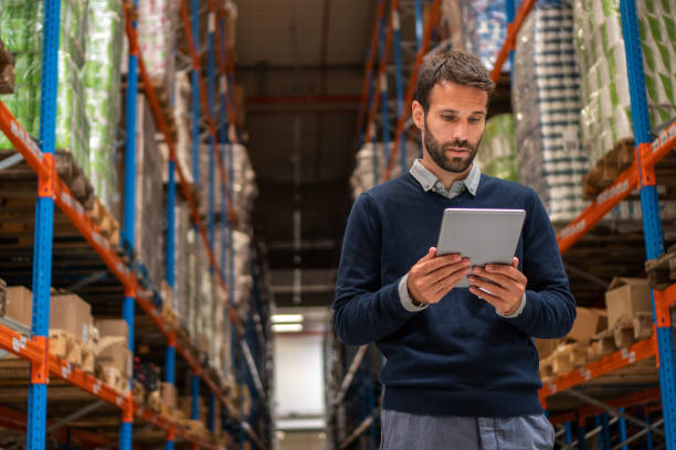 Manager holding digital tablet in warehouse stock photo