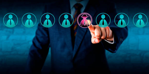 Manager Identifying Potential Insider Threat Corporate security manager identifies a potential insider threat in a line-up of eight white collar workers. Hacker or spy icon lights up purple. Cybersecurity and human resources challenge concept. threats stock pictures, royalty-free photos & images