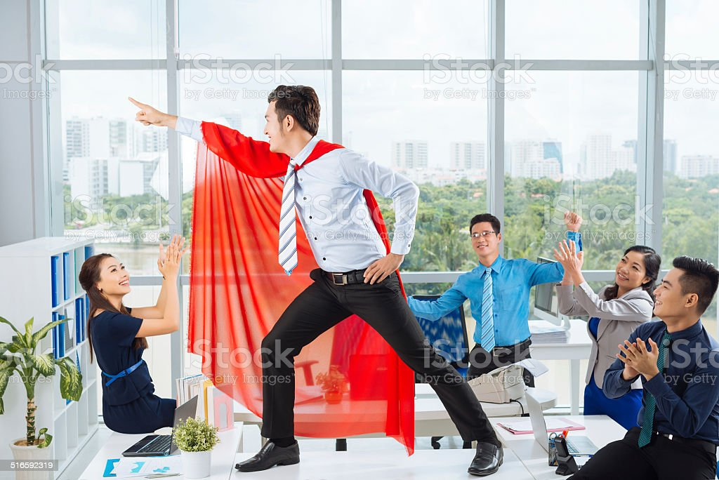 Manager in a red cape stock photo